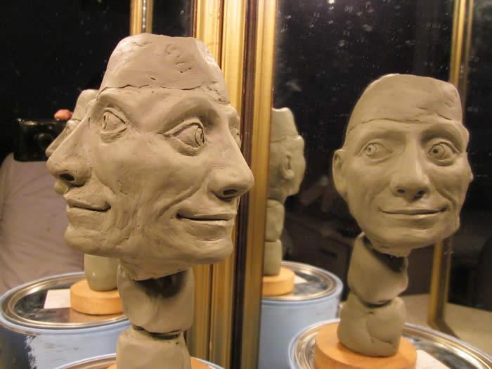 michaelabrahamsculptureinprogresssleepingdogmanhead