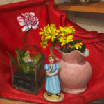 wendy figuring yellow flowers and red fabic still life